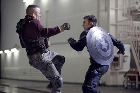 "Batroc (Georges St-Pierre) and Cap (Chris Evans) go toe-to-shield in one of the many incredibly choreographed fight scenes from ""The Winter Soldier""."