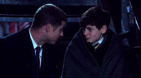 Detective Gordon (McKenzie) comforts a shattered Bruce Wayne (Mazouz).